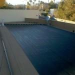 black heating tube on flat roof